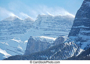 Snow spindrift on mountain peak - Snow blowing off top...