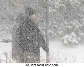 Snow Storm - Two people walking in a snow-storm