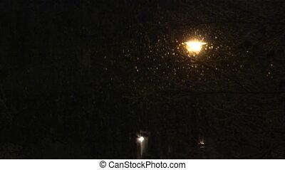 snow street light - Snow falling in front of a street light...