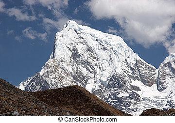 Snow summit of Cholatse mountain, Himalaya - Cholatse...