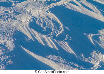 Snow texture on a sunny day