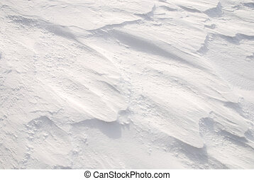 Texture of a fresh fallen snow on a field