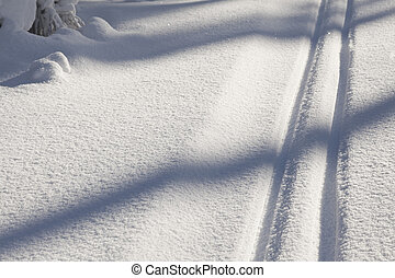 snow texture with cross country skiing traces