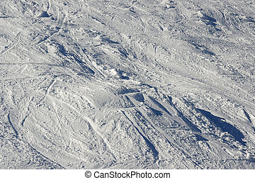 Snow texture with traces of skiing and snowboarding