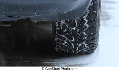 Snow tire tread. - Closeup of snowtire on SUV during...