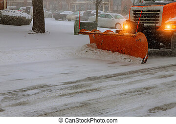 Snow tractor removes snow during snowfall