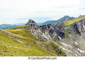 Snow valley in Fagaras Mountains in summer season