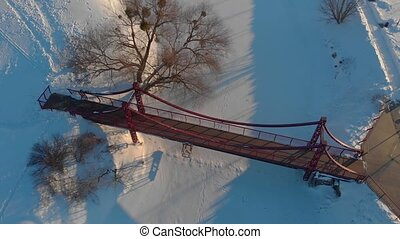 Snow winter bridges before sunset aerial drone top view beautiful push out backward tilt up camera movement Irpin Ukraine