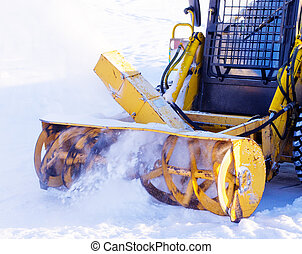 Snowblower removes snow