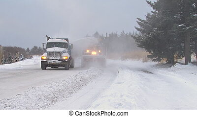 Snowblower & Truck Clearing Street - Snow blower on an...