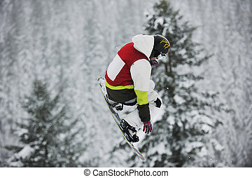 snowboard jump - young boys jumping in air ind showing trick...