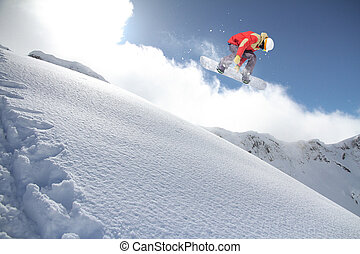 Snowboard rider jumping on mountains. Extreme snowboard...