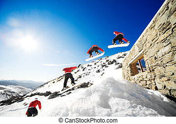 Snowboard sequence - Sequence shot of snowboarder jumping...
