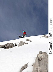 Snowboarder at the top of a mountain