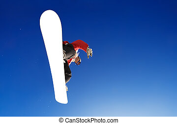 Snowboarder - Crossover board sport shot of snowboarder over...