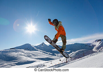 Snowboarder does the jumping trick