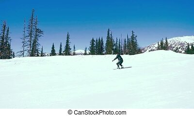 Snowboarder downhill in slowmotion, snow-capped mountains. 1920x1080