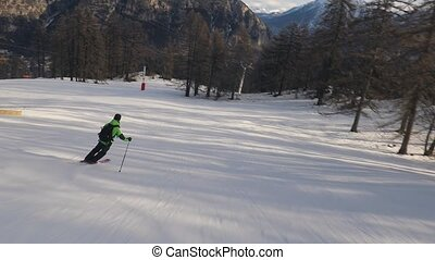 Snowboarder follow shot - Skiing in the alps, going fast,...