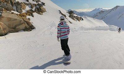Snowboarder follow shot - Snowboarding in the alps, follow...