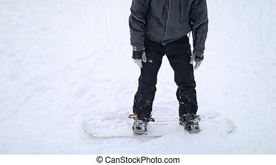 Snowboarder Getting Up to Start Skiing - Snowboarder Getting...
