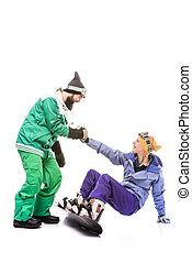 snowboarder helping girlfriend to get up