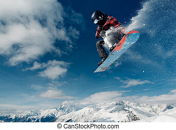 snowboarder is jumping with snowboard from snowhill very...