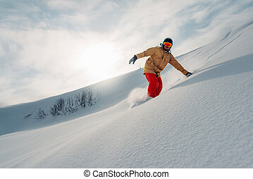 snowboarder is riding from snow hill