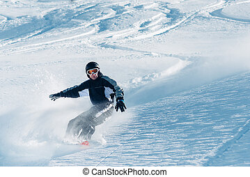 snowboarder is riding from snow hill - snowboarder is riding...