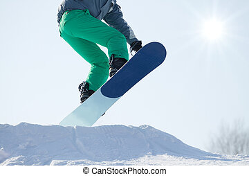 Snowboarder jumping a