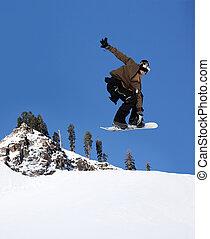 Snowboarder jumping high at Lake Tahoe resort