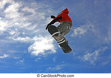 Snowboarder jumping high in the air - Young snowboarder ...