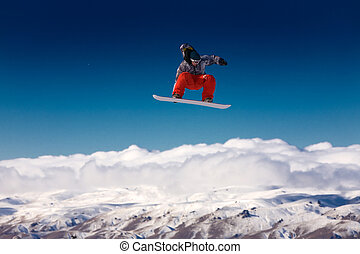 Snowboarder jumping in air - Snowboarder in the air with...