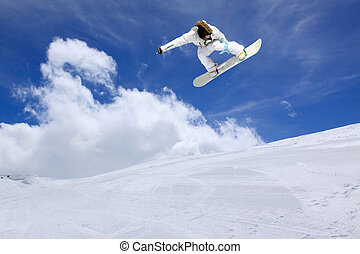 Snowboarder jumping in the air - Snowboarder jumping high in...