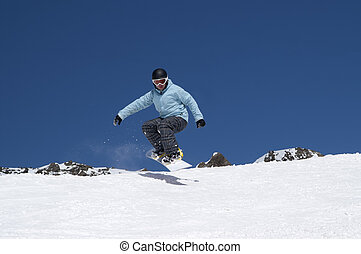 Snowboarder jumping in the mountains - Snowboarder jumping...