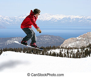 Snowboarder jumping with a beautiful view