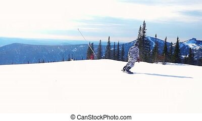 Snowboarder man in suit of kigurumi of zebra downhill in slowmotion, snow-capped mountains on the sun background. 1920x1080