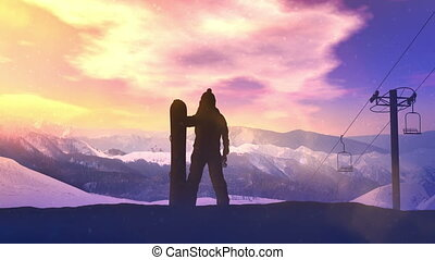 Snowboarder on a background of sunset in the mountains.
