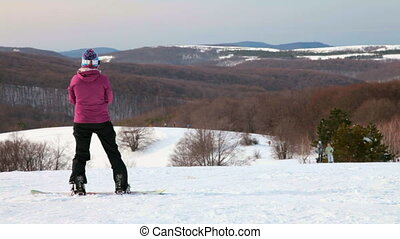 Snowboarder on mountain - snowboarder getting ready to...