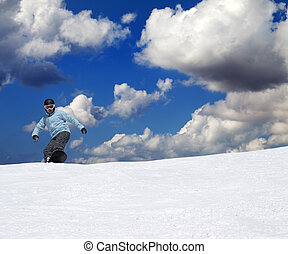 Snowboarder on off-piste slope at nice sun day