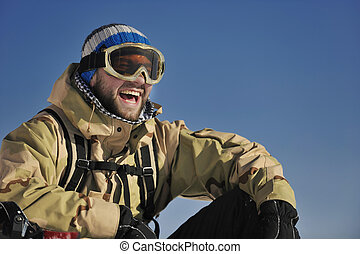 snowboarder portrait - snowboarder relaxing and posing at ...