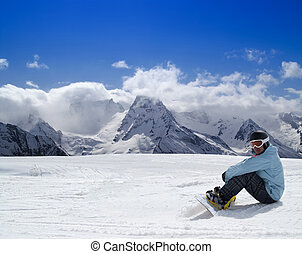 Snowboarder resting on the ski slope. Caucasus Mountains,...