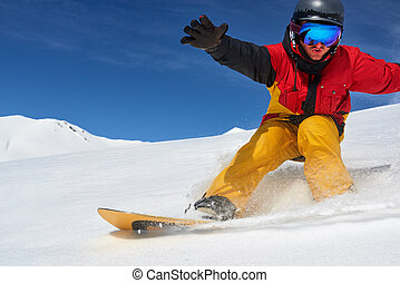 Snowboarder riding fast on dry snow freeride slope. -...