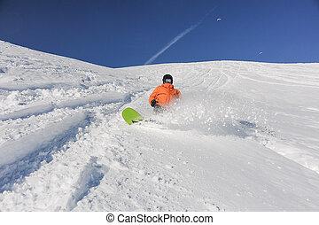 Snowboarder running down the hill in Gudauri, Georgia - Man...