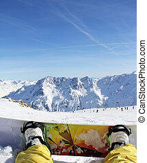 Snowboarder sitting on snow