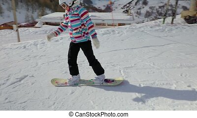 Snowboarder starting to slide - Snowboarding in the alps,...