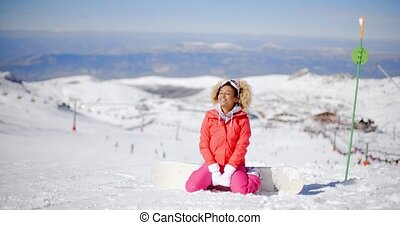 Snowboarder wearing white gloves on her knees - Cute female...