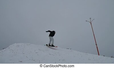 snowboarder winter sports jumping in the snow in the...