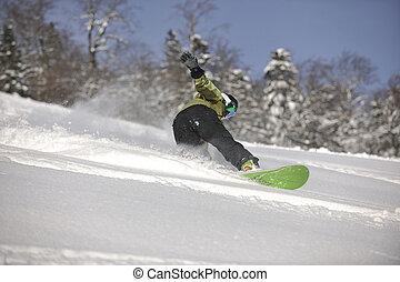 snowboarder woman enjoy freeride on fresh powder snow