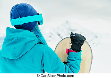 Snowboarder woman in winter.