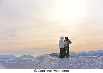 snowboarder's couple on mountain's top - happy young ...